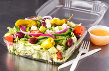 Carry Out Greek Salad In A Plastic Container