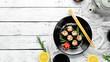 Sushi maki with eel, rice and Unagi sauce. Japanese food set. Top view