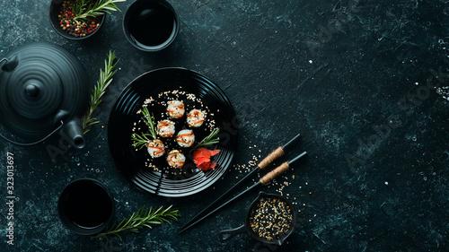 Fototapeta Sushi maki with eel, rice and Unagi sauce. Japanese food set. Top view obraz