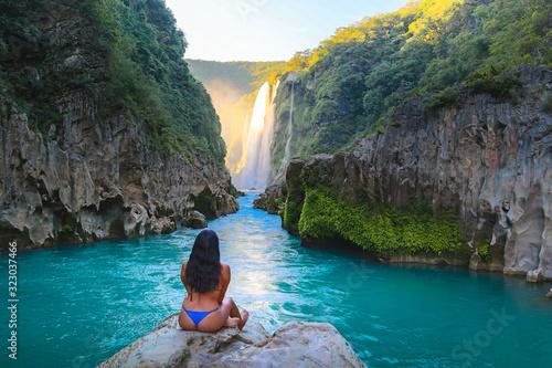TAMUL, SAN LUIS POTOSI MEXICO - January 6, 2020:young women posing in River amazing crystalline blue water of Tamul waterfall - 323037466