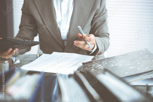 Bookkeeper woman or financial inspector making report, calculating or checking balance, close-up Wallpaper Mural