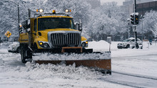 Large Snowplow In The Snow