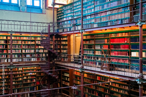 Photo Amsterdam, Netherlands - Nov 2019: A wide angle shot showing the books in the Rijksmuseum Research Library, largest public art history research library in the Netherlands