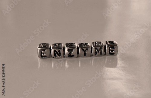 Photo Enzyme -  word from metal blocks - concept sepia tone photo on shine background
