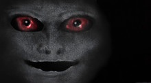Scary Creature With Red Eyes. Portrait Of An Alien Or Demon. A Vision From A Nightmare. Vampire Face On A Dark Background. Scary Face.