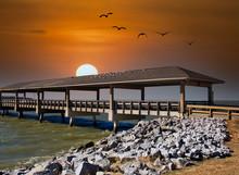 An Old Pier By A Rock Seawall ...