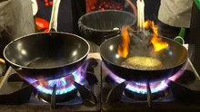 Cooking Seafood In Pan With Fl...