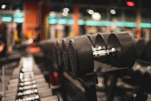 Fototapeta Gym and dumbbell weight training equipment on sport ,Healthy life and gym exercise equipments and sports concept ,copy space obraz