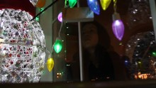 Lonely Teen Looking Sadly Into Store Window Full Of Christmas Decorations