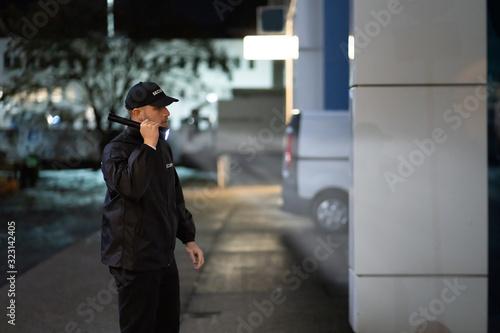 Fotografia, Obraz Security Guard Walking Building Perimeter