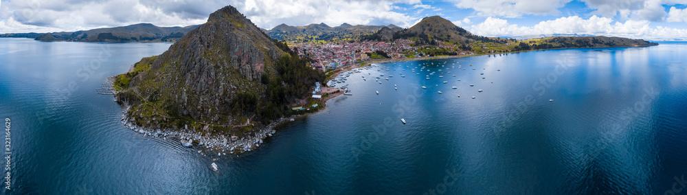 Fototapeta Aerial panorama of the lake of Titicaca, Cerro Calvario and the town of Copacabana, Bolivia