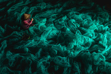 A Fisherman Who Mends His Net Indoors