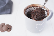 Homemade Chocolate Mug Cake On A White Background
