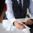 Man in suit and tie give hand as hello in office closeup. Friend welcome mediation offer positive introduction thanks gesture summit executive approval motivation male arm strike bargain