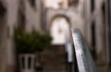 Fototapeta Fototapety na drzwi -  An iron railing in focus on blurred background