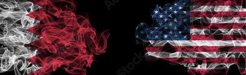 Photo Flags of Bahrain and USA on Black background, Bahrain vs USA Smoke Flags