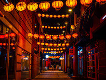 Traditional Chinese Lanterns In The Night. Looking Down A Street In China Town.
