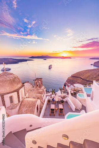 Obraz Amazing evening view of Santorini island. Picturesque spring sunset on the famous Greek resort Fira, Greece, Europe. Traveling concept background. Artistic style post processed photo. Summer vacation - fototapety do salonu
