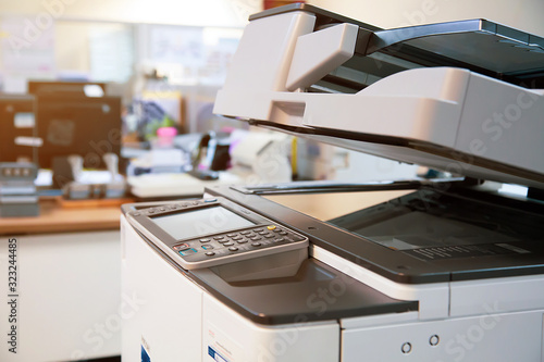Fotomural Close-up photocopier or printer is office worker tool equipment for scanning and copy paper