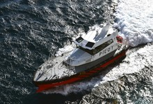 Pilot Boat Creating White Wate...