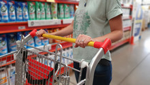 Woman And Shopping Cart Superm...