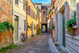 Fototapeta Uliczki - Cozy narrow street in Ferrara, Emilia-Romagna, Italy. Ferrara is capital of the Province of Ferrara