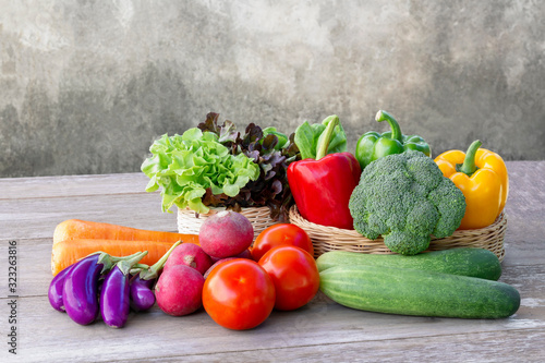 Online order grocery shopping concept. Food delivery ingredients service at home for cooking on wood table for lifestyle in city with copy space for text. © nicemyphoto