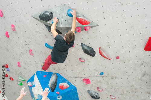 Man climbing in a bouldering gym Canvas Print