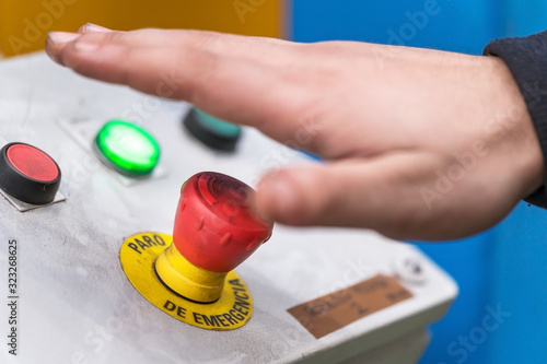 Obraz Hand pressing the red emergency button or stop button for industrial machine, Emergency Stop for Safety . - fototapety do salonu
