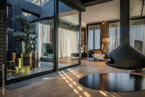 Fototapeta Interior of a luxury open plan apartment with fireplace