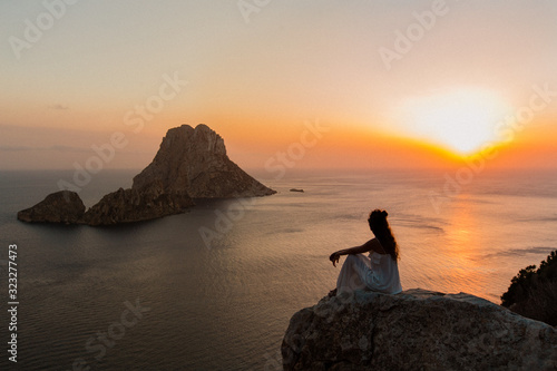 Woman looking at a beautiful sunset in Ibiza