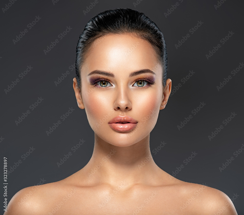 Fototapeta Front portrait of the woman with beauty face - isolated. Beauty face of the young beautiful girl with a healthy skin.  Skin care concept.