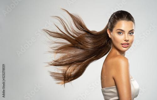 Obraz Portrait of a beautiful woman with a long straight hair. - fototapety do salonu