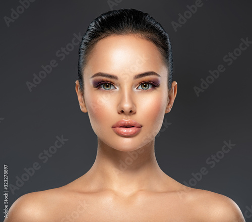 Front portrait of the woman with beauty face - isolated. Beauty face of the young beautiful girl with a healthy skin.  Skin care concept. Wall mural
