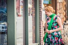 Woman In Retro Dress Walking D...