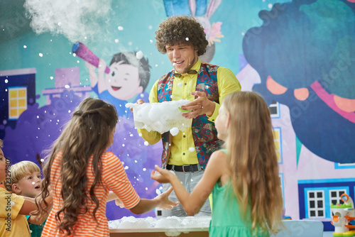 Animator showing chemistry experiments for kids. Dry ice boo bubbles experiment. City of professions for children.