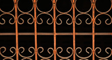 Wrought Iron Grilles On A Blac...
