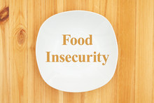 Food Insecurity Message On White Empty Plate