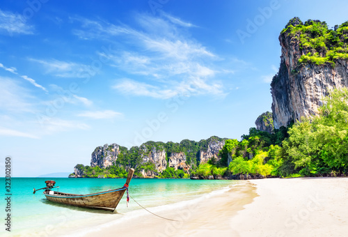 Thai traditional wooden longtail boat and beautiful sand beach. Canvas Print