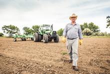 Farmer With Cowboy Hat Walking...