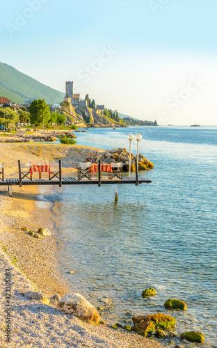 Carta da parati Beautiful peaceful lake Garda, Italy. Sunset.