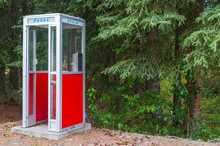 A Red Phone Booth In The Forest In Slana, Alaska