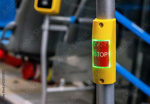 Obraz Red stop button in public transport. Bus stop button at the request of the passenger. - fototapety do salonu
