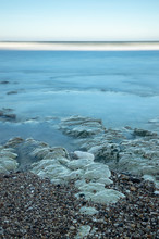 Waves Over A Rocky Shore In Flamborough At North Landing