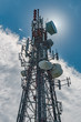 canvas print picture - cell phone tower partial silo with sun