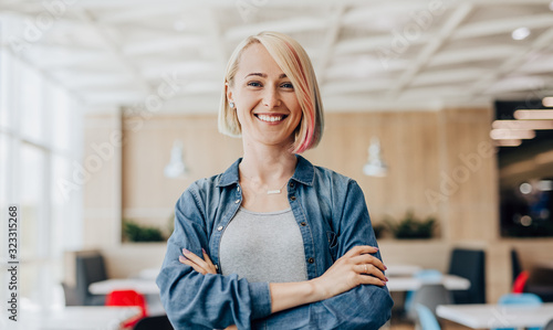 Positive young casual woman looking at camera