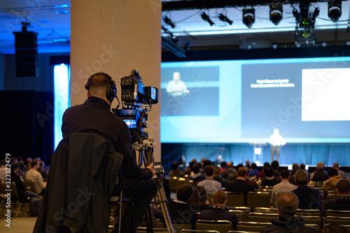 Fototapeta イベントを撮影するビデオグラファー obraz