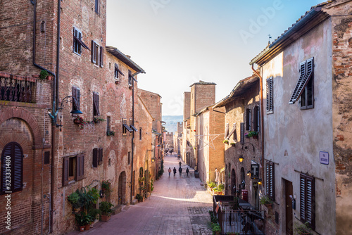 Certaldo, Tuscany, Italy - December 2019: View of the main cobbled street in the Canvas Print