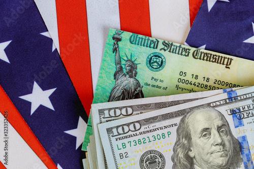 Cuadros en Lienzo Stimulus economic tax return check and US 100 dollar bills currency with US flag