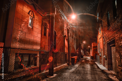 Dark and eerie urban city alley at night in the winter Wallpaper Mural